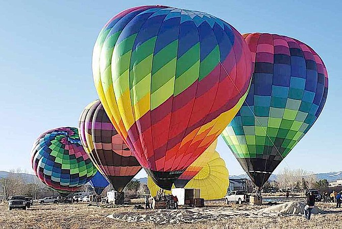 Hot air balloons gather south of Gardnerville on April 10 in this photo taken by Lisa Coffron of the Sierra Scoop.