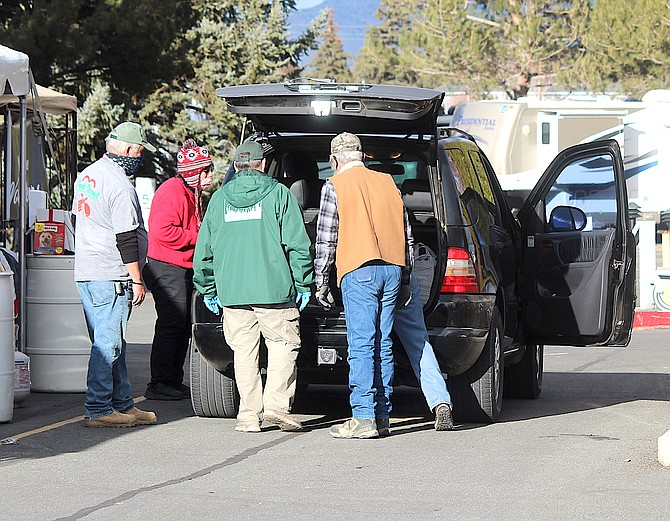 Volunteers help unload donations at last year's Share Your Holiday Food Drive at the Carson Valley Inn in Minden. The 2021 food drive is scheduled for December 10.