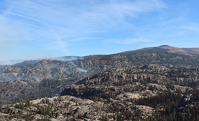 Smoke from fires north of Highway 88 off Carson Spur rises on Thursday morning.