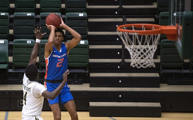 Boise State guard Derrick Alston Jr. shoots as Colorado State guard Isaiah Stevens defends Wednesday in Fort Collins, Colo.