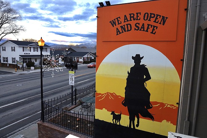 A mural welcomes and reassures shoppers that Gardnerville is open and safe.