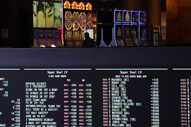 Betting odds for Super Bowl 55 are displayed on monitors at the Circa resort and casino sports book on Wednesday in Las Vegas. (John Locher/AP)