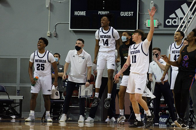 Nevada players celebrate during Friday's victory against Boise State at Lawlor Events Center in Reno. (Photo: University of Nevada)