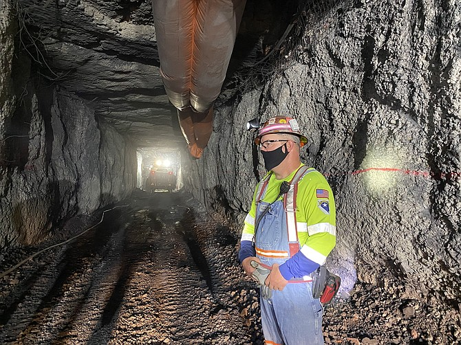A Nevada Gold Mines employee stands inside a mine site in July 2020.