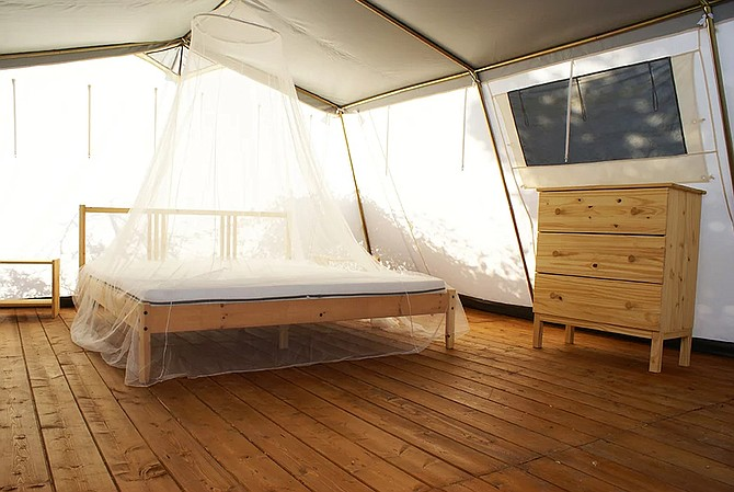 Among other services, the company undertakes canvas repair projects, such as for luxury tents, seen here.