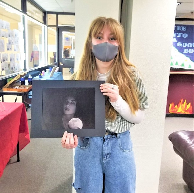 CHS student Alanah Jackson with her first place piece Seeing the Light in The Dark
