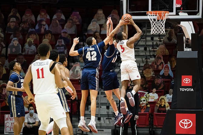 San Diego State's Lamont Butler drives to the basket against Nevada earlier this season in San Diego. (Photo: San Diego State University)