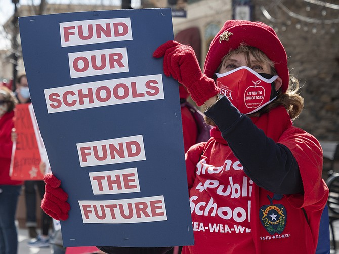 Nevada teachers and the Nevada State Education Association hold a rally demanding more funding outside of the state Legislature in Carson City on Monday. (photo: Bob Conrad/This Is Reno via AP, pool)