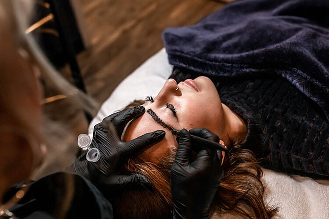 A customer at SBK Beauty and Lash Parlour in Reno gets microblading done on their eyebrows.
