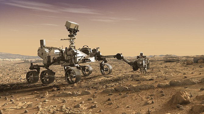 """An artist's rendition of the Perseverance Rover """"studying rocks with its robotic arm."""""""