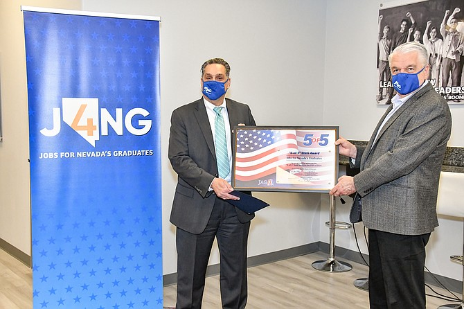 Dr. René Cantú and Gov. Steve Sisolak at the J4NG 5-of-5 award ceremony in October 2020.