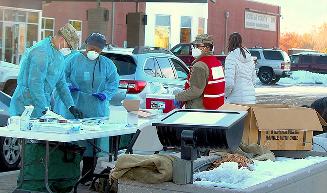 National Guard and health workers at a community testing event before Thanksgiving