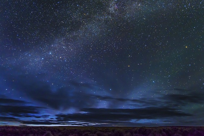 "In this May 2, 2017 photo provided by Kurt Kuznicki is the Massacre Rim Wilderness Area in northwestern Nevada, 150 miles north of Reno and near the state line with Oregon. Massacre Rim is one of two areas designated as ""dark sky sanctuaries"" in Nevada. A bill passed by the Nevada state Senate would create a state program to encourage tourism and preservation of dark sky places. (Kurt Kuznicki via AP)"