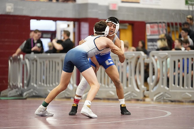 Carson High's Ariel Vega wrestles at Cimarron-Memorial High School last February during the 2020 NIAA Class 4A State Wrestling Tournament. Vega, along with six other Senator wrestling teammates, won't get a senior season due to the ongoing pandemic.