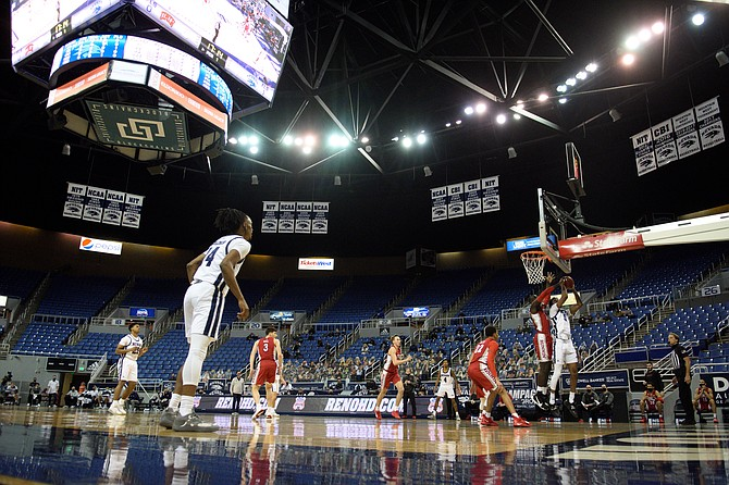 Photo: University of Nevada The Nevada men's basketball team, shown against UNLV in Reno on Jan. 31, is scheduled to return to the court this weekend after a two-week, COVID-19-related break.