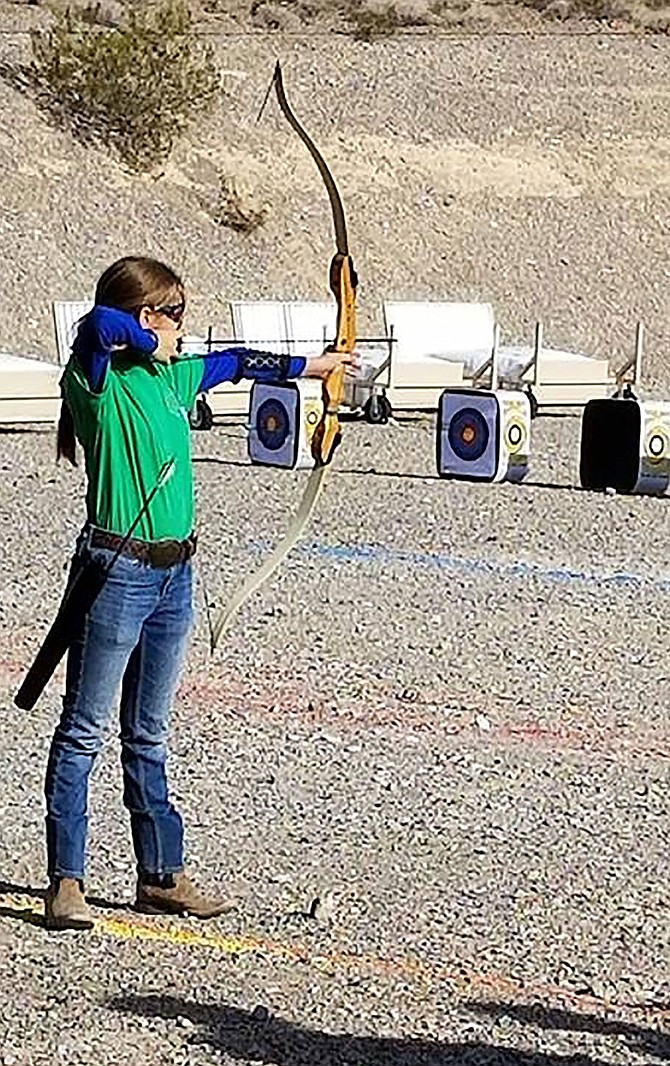Silver State Wrangler 4-H Club Archer competes at the Shooting Sports State Match prior to COVID-19 epidemic.