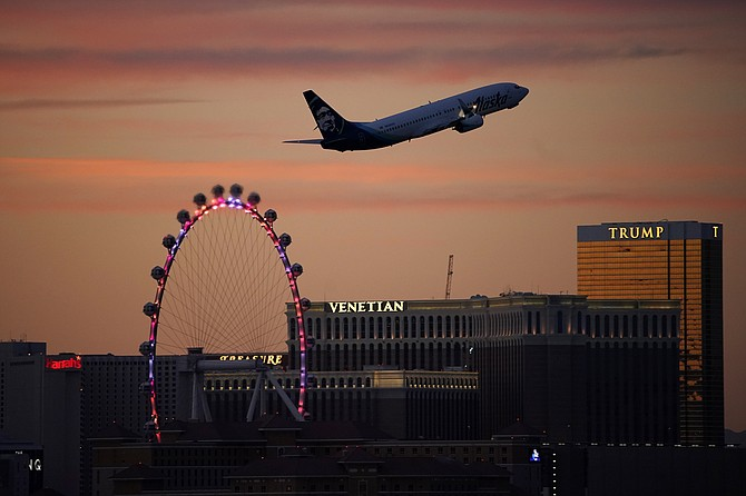 Photo: John Locher/AP A plane takes off from McCarran International Airport on Tuesday in Las Vegas.