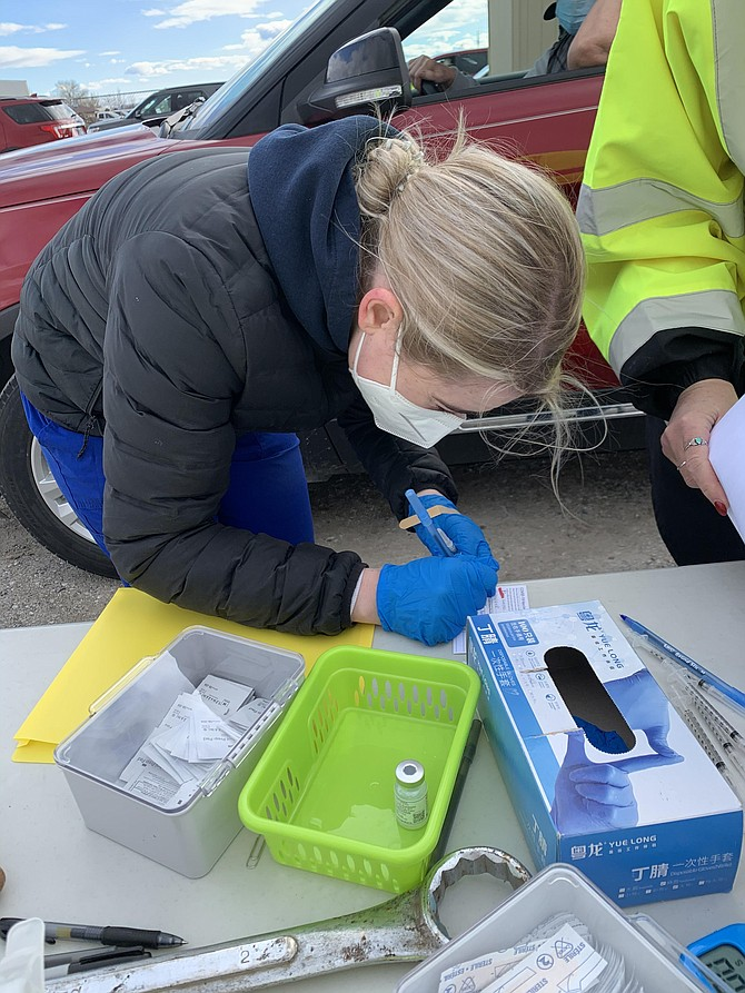 Western Nevada College nursing student Ivy Kent administers a COVID vaccination in Fallon.