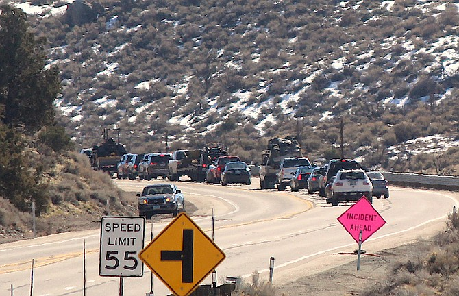 Cars wait for Highway 395 to reopen around lunchtime Tuesday after a fatal collision claimed the life of a Carson City man.