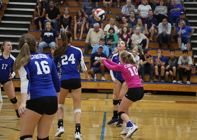 Carson's Camille Kordonowy bumps a ball while fans look on during the 2019 fall season. Carson City School District announced its new spectator policy Wednesday morning for athletic events.