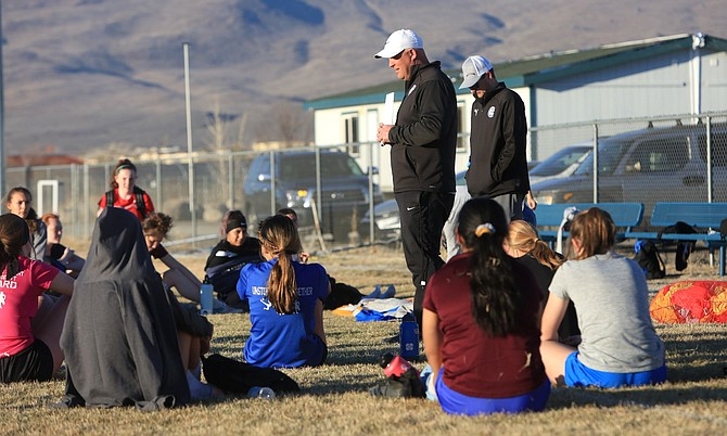 Carson High girls' soccer coach Kyle Walt chats with the team following practice Monday evening. Walt and his three senior captains think the Senators could surprise some teams this year.