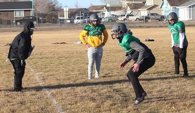 Fallon head coach Brooke Hill, left, works with his players on drills.