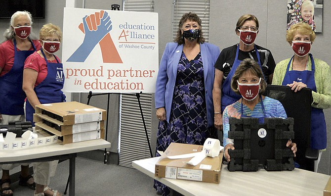 The Assistance League worked with Education Alliance to donate over 430 laptops for Washoe County school studentns.