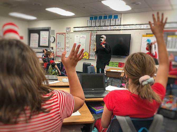 """Reading Week.jpg: Fremont Elementary School Principal Dr. Jennifer Ward-DeJoseph dressed up as the principal from Dr. Seuss' book """"Hooray for Diffendoofer Day"""" and read to Muriel Troyner's fourth-grade class."""