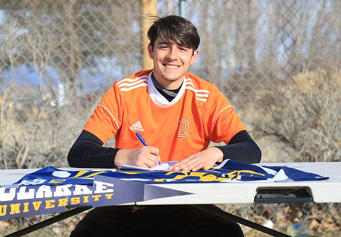 Douglas High senior Ricky Diaz smiles after signing his national Letter of Intent to play men's soccer at Clarke University next year. Diaz will join his older sister, Vaneza, in Dubuque, Iowa next fall.