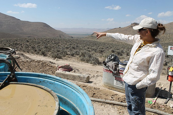 Melissa Boerst, a Lithium Nevada Corp. geologist, points to an area of future exploration from a drill site at the Thacker Pass Project in Humboldt County on Sept. 13, 2018. A new federal lawsuit is challenging the construction of a huge Nevada lithium mine approved in the final days of the Trump administration. It says the U.S. Environmental Protection Agency and state wildlife officials repeatedly warned the plans don't comply with laws protecting water and wildlife near the Oregon line. (Suzanne Featherston/The Daily Free Press via AP)