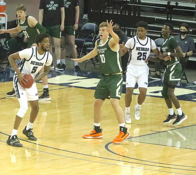Photo: Steve Ranson/LVN Nevada's Warren Washington (5) looks for an open Wolf Pack player during Friday's game against Colorado State in Reno.