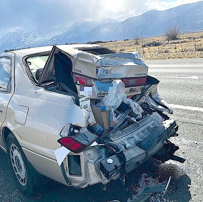 A Toyota was rear-ended in a hit and run collision that occurred in the turn lane at Highway 395 and Stephanie Way.