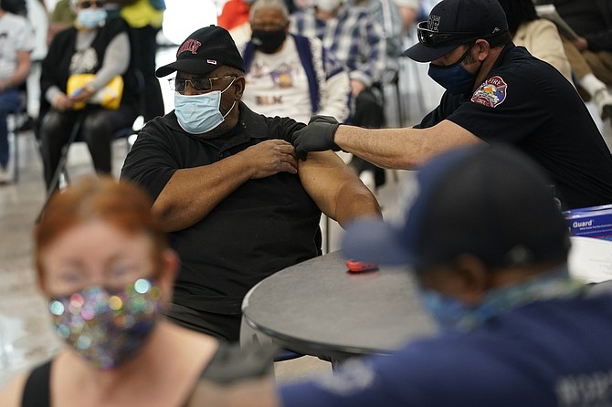 People receive a COVID-19 vaccine at the Martin Luther King Senior Center in North Las Vegas on Feb. 10. (Photo: John Locher/AP)