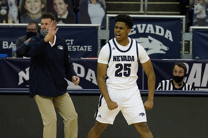 Nevada's Grant Sherfield (shown with coach Steve Alford during Friday's game against Colorado State) was named the Mountain West's newcomer of the year. (Photo: University of Nevada)