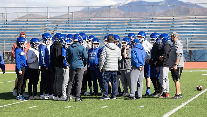 The Carson High football team listens to head coach Blair Roman during practice last week. The Senators will have plenty of youth on the roster this season, but Roman and the rest of the coaching staff expects to see some bright spots turn out after the shortened season.