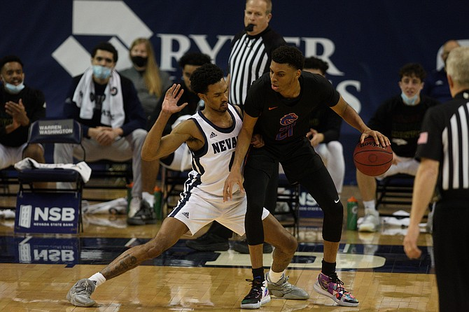 Nevada's Desmond Cambridge guards Boise State's Derrick Alston during their Feb. 5 game in Reno. The teams face each other Thursday in the Mountain West tournament. (Photo: University of Nevada)