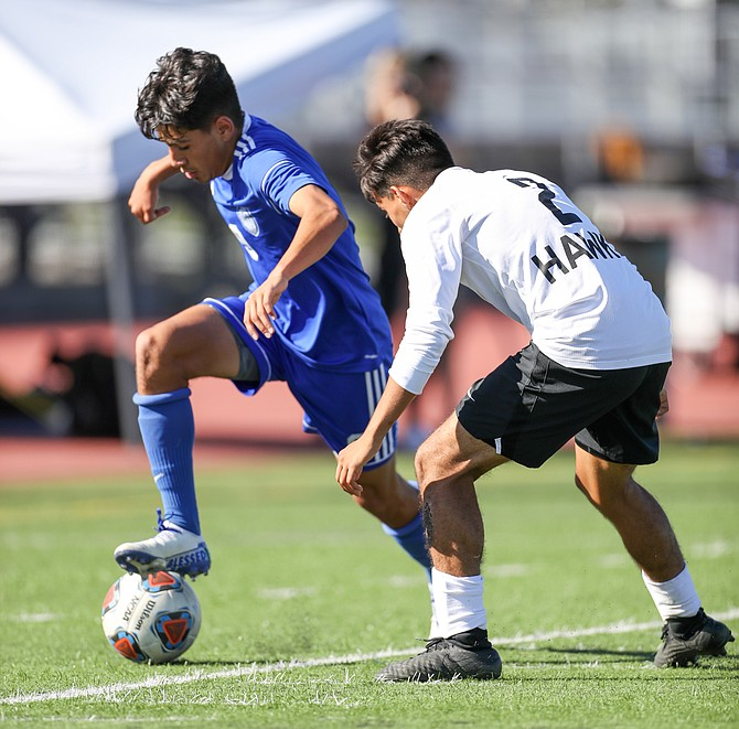 Carson high's Omar Mora works against a hug defender during the 2019 fall season. Mora had a hat trick in the Senators' opening contest of the 2021 spring season against Galena.