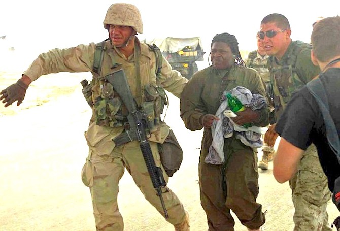 Spec. Shoshana Nyree Johnson, second from left, was rescued by U.S. Marines on April 13, 2003.