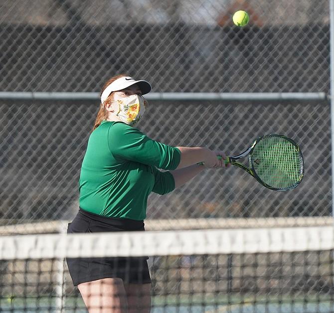 Fallon senior Allison Frost prepares her backhand swing in her doubles match against Sparks on Thursday.