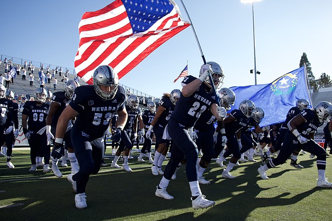 The Nevada football team, shown taking the field to face Wyoming last season, could have it's best season in history in 2021, columnist Joe Santoro writes.