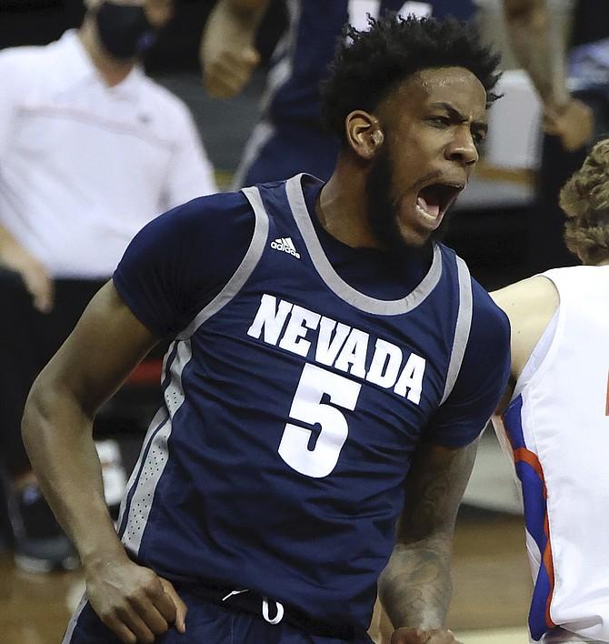 Nevada forward Warren Washington (5) reacts after dunking against Boise State on Thursday, in Las Vegas. (AP Photo/Isaac Brekken)