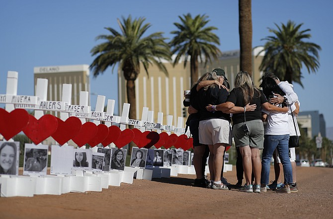 People pray at a makeshift Las Vegas memorial Oct. 1, 2019 on the anniversary of the mass shooting two years earlier. (Photo: John Locher/AP, file)