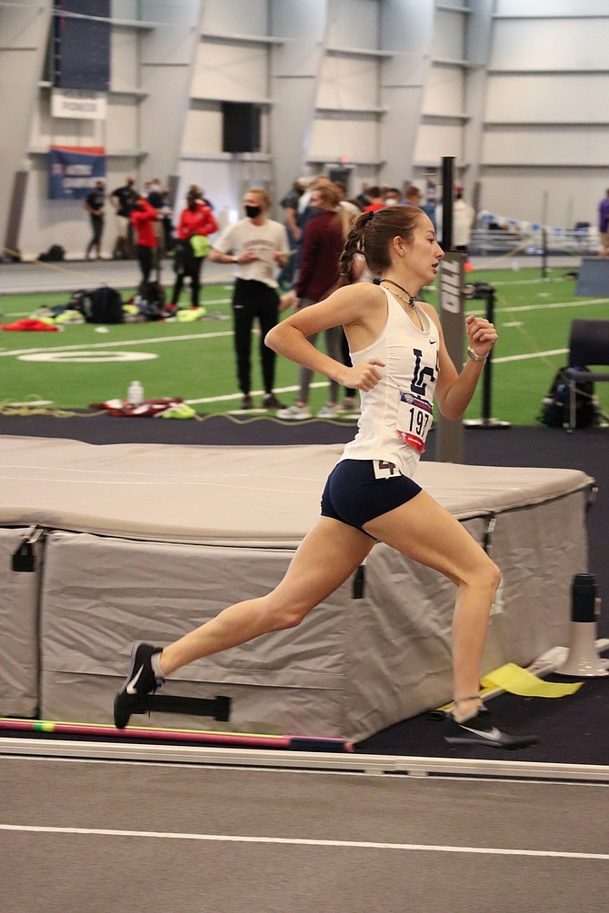 Carson High graduate and Lewis-Clark State College sophomore Ashley Britt runs around a turn at Mount Marty University during the NAIA Indoor Championships in early March.