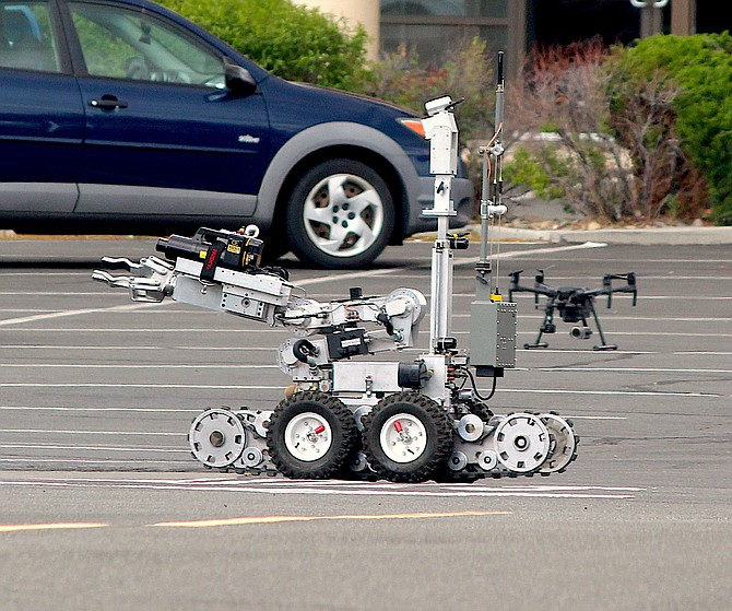 The Tahoe Douglas Bomb Squad robot approaches a suspicious package in Gardnerville on June 15, 2020.