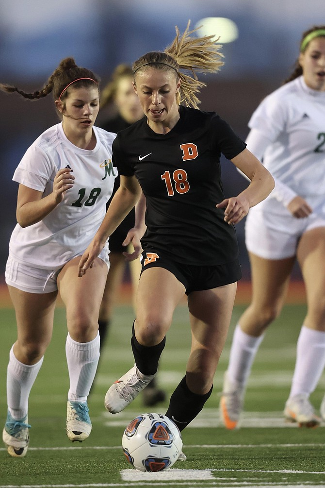 Douglas High's Helene Henry-Greard dribbles in front of a Bishop Manogue defender Tuesday night. Henry-Greard had a couple of shots on goal and was fouled in the box, drawing the Tigers a penalty kick.