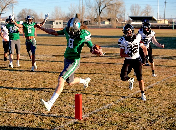 Thomas Ranson/LVN Quarterback Avery Strasdin stretches for a touchdown in the fourth quarter for Fallon.