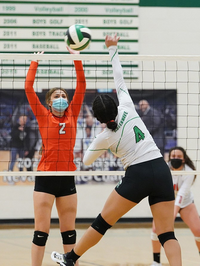 Thomas Ranson/LVN Fallon senior Aisha Sharon goes up for the attack against Fernley in Wednesday's 3A East match.