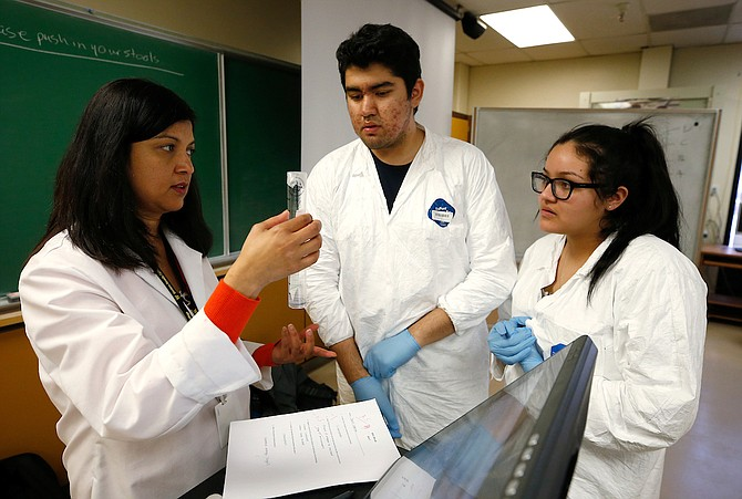 Courtesy WNC Smriti Bhattarai, a biology professor at WNC, works with students in a biology lab. Bhattarai has been leading students in Nevada INBRE research projects at the Carson campus. She was recently one of three WNC professors awarded tenure by NSHE.