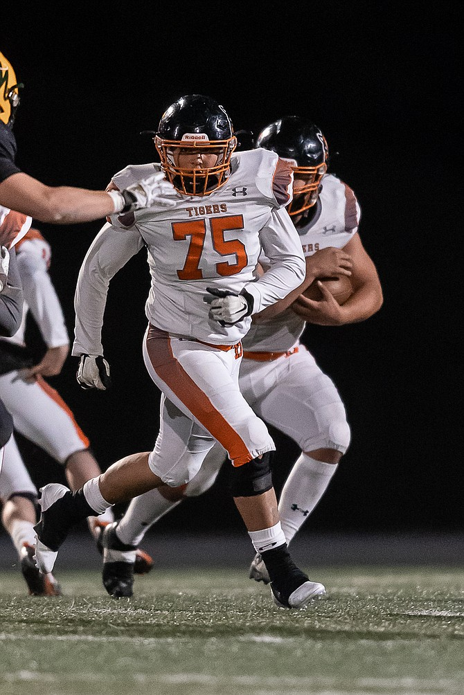Douglas High offensive lineman Yahir Piña comes out to block for a Tiger running back against Bishop Manogue during Week Two.