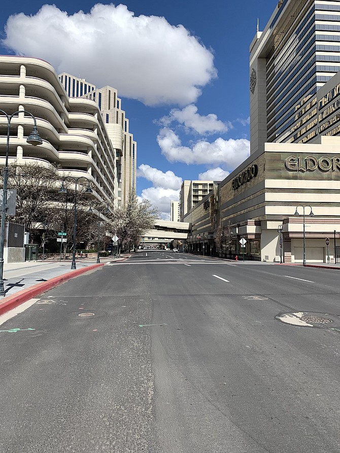 At the onset of the pandemic's shutdown of businesses across the Silver State, Downtown Reno (seen here March 21, 2020) was eerily quiet and void of traffic.